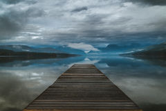 Lake dock on an overcast day. Image of a lake dock on an overcast day Royalty Free Stock Photo