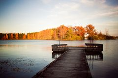 Lake with Dock. Pretty changing colors Stock Photo