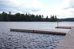 Lake docks. Wooden boat docks on a lake royalty free stock photos