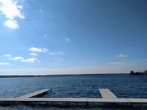 Lake Docks. Dock on a blue sky Beautiful spring day in Pure Michigan. Enjoyed and captured in April 2017 Stock Image