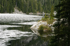 Lake Dorothy Ice Floe. In late spring, the surface of Lake Dorothy in the Washington Cascades is still barely covered with ice. The frozen surface of this alpine Royalty Free Stock Photography