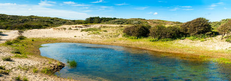 Lake in dunes Royalty Free Stock Image