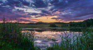 Lake before dusk, beautiful sky clouds royalty free stock photos