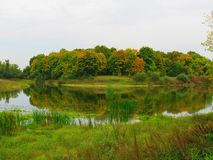 Lake in early autumn, trees in the background stock photography