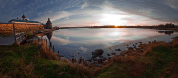 Lake in early morning. Panoramic view on Solovetsky Monastery and Holy Lake on sunrise stock images