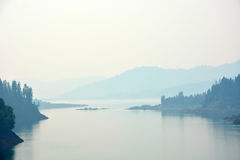 Lake at early morning. With fog Royalty Free Stock Photos
