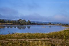 Lake early in the morning with a fog. Beautiful landscape. Lake early in the morning with a fog Stock Photography