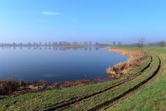 Lake early morning. Still water Royalty Free Stock Image
