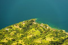 Lake Edge. Lake Atitlan lake edge with calm blue water royalty free stock photos