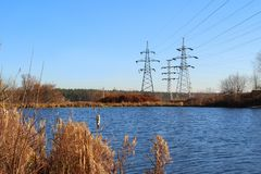 Lake and electric poles on the opposite bank. Stock Image