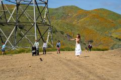 Lake Elsinore, California - March 22, 2019: Tourists, hikers,  social media influencers and models in costume take pictures and stock photos