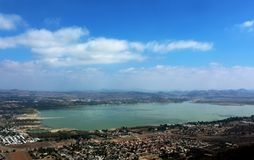Lake Elsinore Landscape. The landscape view of the whole Lake Elsinore, California, from the mountain with blue sky and the city landscape royalty free stock photos
