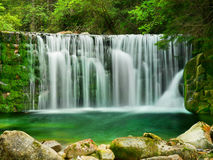 Lake Emerald Waterfalls Forest Landscape. Beautiful Emerald Lake -  scenery of forest waterfalls landscape flowing in summer Stock Images