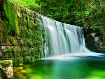 Lake Emerald Waterfalls Forest Landscape. Beautiful Emerald Lake -  scenery of forest waterfalls landscape flowing in summer