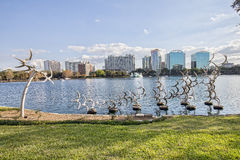 Lake Eola. In a downtown park of Orlando, Florida, with a large sculpture of seagulls Royalty Free Stock Image
