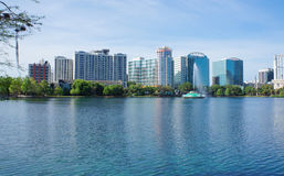 Lake Eola, High-rise buildings, skyline, and fountain. High-rise buildings, skyline, and fountain in Lake Eola at Downtown Orlando, Florida, United States, April Royalty Free Stock Images