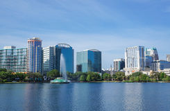 Lake Eola, High-rise buildings, skyline, and fountain. At Lake Eola, High-rise buildings and fountain in Orlando, Florida, United States, April 27, 2017 Royalty Free Stock Images