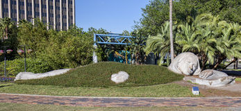 Lake Eola Statue. A giant statue, half buried in the ground, at Lake Eola in downtown Orlando, Florida Stock Photos