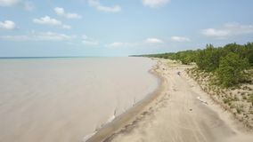 Lake Erie, beach and turbid water after storm. Aerial view. 4k. Lake Erie, Aerial view. Flying with drone above and along beach and lake after storm stock video footage