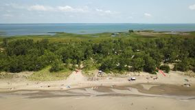 Lake Erie, beach and turbid water after storm. Aerial view. 4k. Lake Erie, Aerial view. Flying back with drone above beach and lake after storm stock video