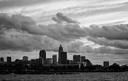 Black and White Shot of a Sunset over Downtown Cleveland. Lake Erie is a great place in NE Ohio to enjoy a brilliant summer night. The Clouds provide a dramatic stock photo
