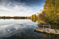 Lake at evening in autumn Stock Photos