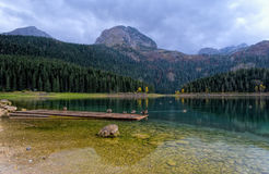 Lake in evening. Scenery of mountain glacier lake in autumn evening Stock Photo