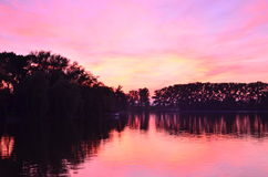 Lake. Evening lake sunset sky and trees Royalty Free Stock Images