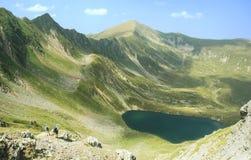 Lake in Fagaras mountains stock photo
