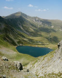 Lake in Fagaras mountains stock images