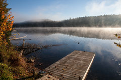 Lake in the fall forest, Canada Royalty Free Stock Photos