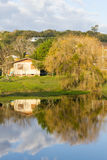 Lake and farm house in winter, Vale dos Vinhedos valley. Bento Goncalves, Rio Grande do Sul, Brazil Royalty Free Stock Images