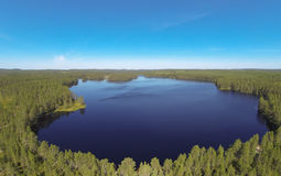 Lake in Finland. Small lake in Finland. At the lake is deep wilderness. Aerial photo Royalty Free Stock Photography