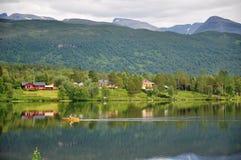 Lake. Fisherman at a lake in Norway Royalty Free Stock Photography