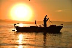 Lake fisherman and overtime work Stock Photos