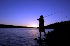 Lake Fisherman at Sunset Stock Photography