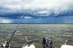 Lake fishing in stormy weather Stock Images
