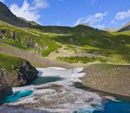 Lake with floes in a mountains Stock Photos