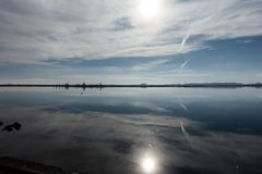 Lake of the flooded city of Epecuen. The sun is reflected in the water between the clouds. Uniric. Landscape royalty free stock images