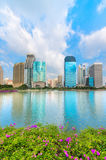 Lake with flower and modern city skyline of business district do Stock Photo