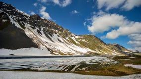 A lake on the Fluela Pass in Graubunden, Switzerland stock image