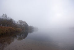 Lake and fog. This picture shows a lake and fog stock images
