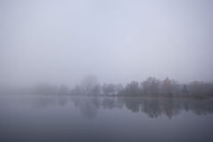 Lake and fog. This picture shows a lake and fog Stock Image