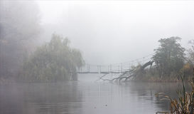 Lake in a fog. The destroyed bridge through lake in a fog Royalty Free Stock Image