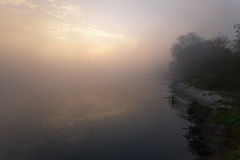 Lake with the fog at sunrise Royalty Free Stock Images