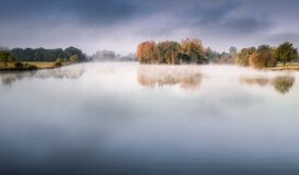 Lake With Fog Under Dark Blue Sky Photography Royalty Free Stock Photo