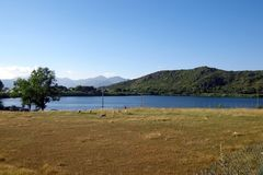 The lake of Fondi, Italy. The lake of Fondi. It has a sickle shape, with its apexes facing the sea, from which it is a few kilometers away Stock Photo