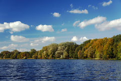 Lake and forest in the autumn Stock Images