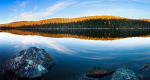 Lake in a forest in autumn in Lapland Royalty Free Stock Photography