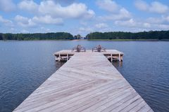 Beautiful landing stage and summer landscape. Royalty Free Stock Photography